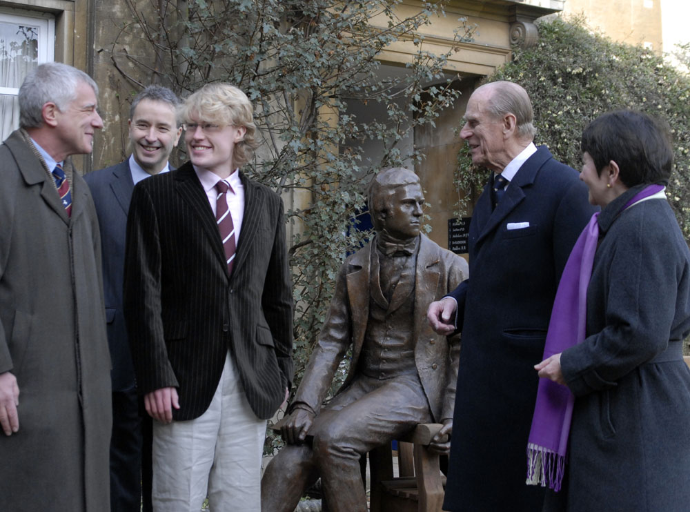 HRH Prince Philip unveiling Anthony Smith's bronze statue of Charles Darwin for Christ's College Cambridge University